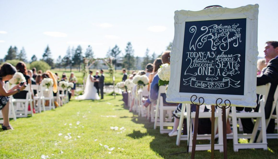 Chalked handlettered wedding sign