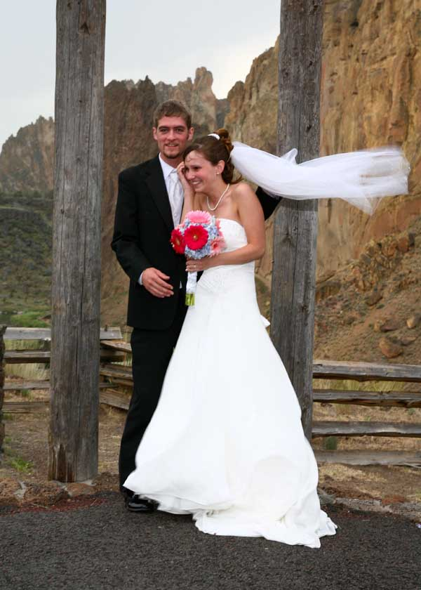 Bride and groom in wind